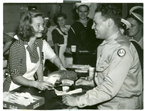 Actress Bette Davis serves cake at the Stage Door Canteen in 1943. The Canteen was located in the Belasco Theater on Lafayette Square, across from the White House.